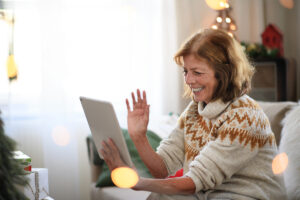senior woman with an iPad